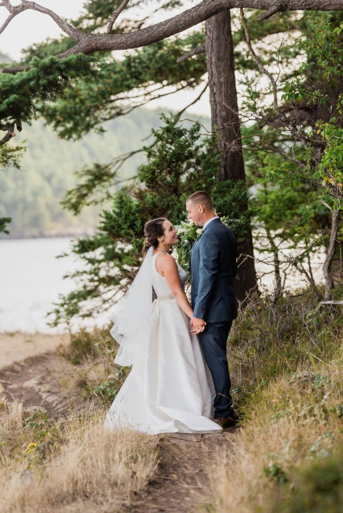 bride and groom looking at each other, holding hands, wedding shot list idea, Pacific Northwest wedding in forest and water islands