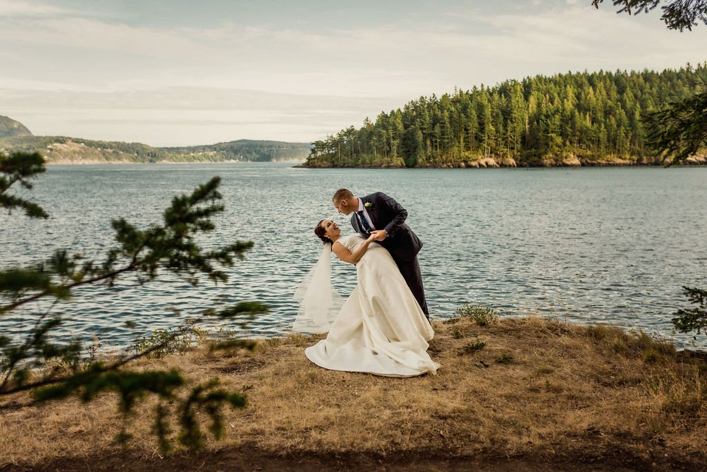 groom dip bride, outdoor beach wedding destination wedding in Pacific Northwest on water