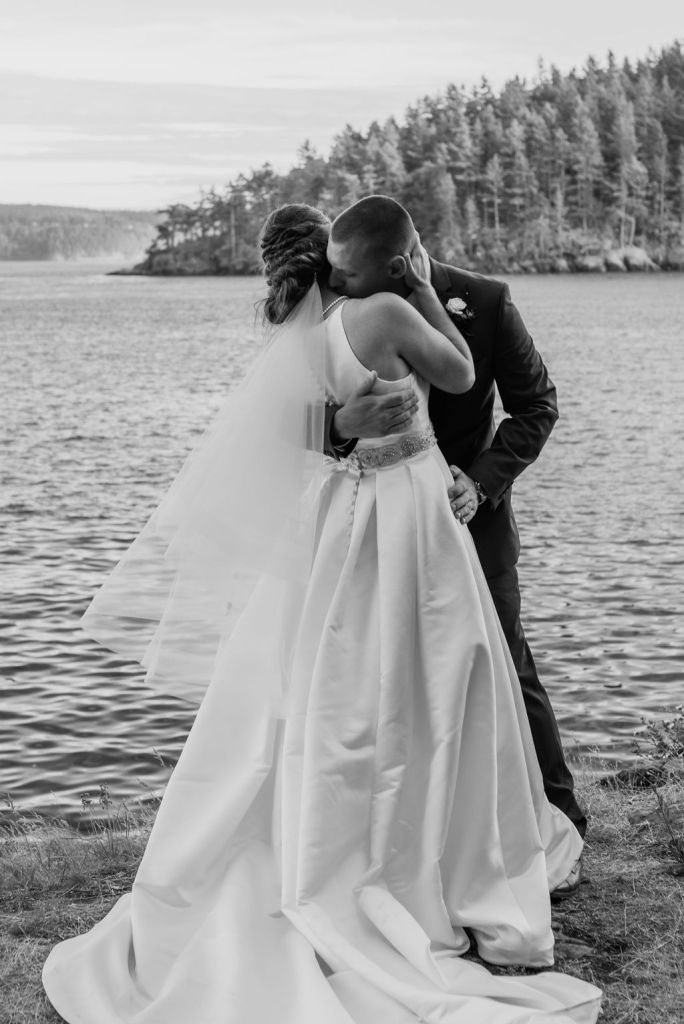 groom kissing bride's neck, pacific northwest destination wedding, beach outdoor wedding, island wedding, black and white wedding photography