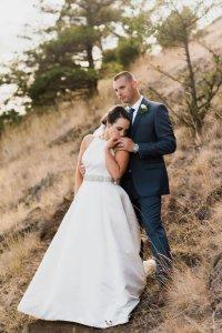 bride and groom on mountain, adventure wedding photography, Pacific Northwest wedding portraits