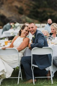 bride and groom laughing at outdoor wedding best man speech