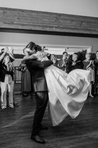 groom swings bride around