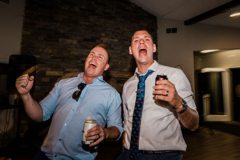 wedding reception songs, wedding guests singing sweet Caroline at wedding reception