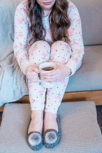 women's cozy pjs with flamingos hot mug of tea