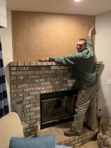 working on an accent wall above the fireplace and creating a template