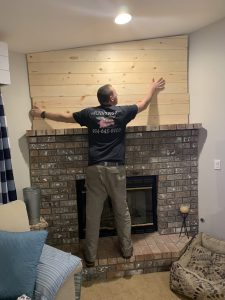 installing shiplap above the fireplace