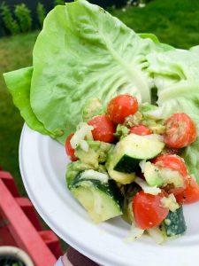 Lettuce wrap burgers with avocado, cucumber & tomato salad