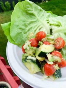 Lettuce wrap burgers with avocado, cucumber & tomato salad
