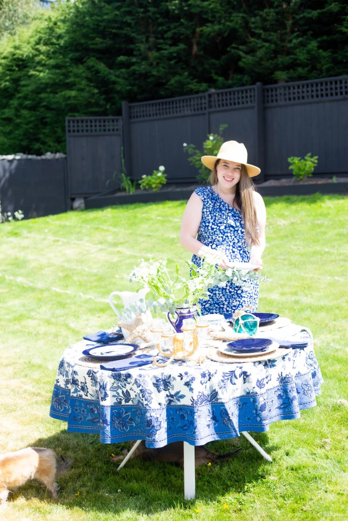 woman in summer dress and outdoor dinner party table