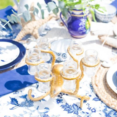 beautiful summer white, blue and gold tablescape. making the everyday a celebration. gold octopus shot holder.