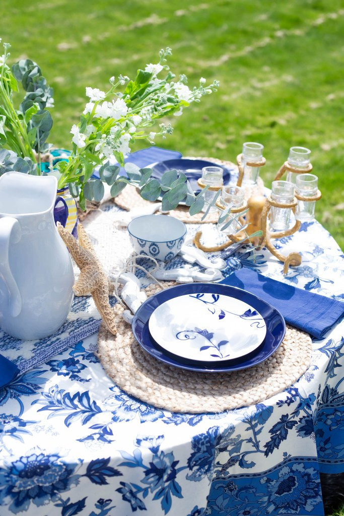 beautiful summer white, blue and gold tablescape. making the everyday a celebration. woven jute seagrass placemat.