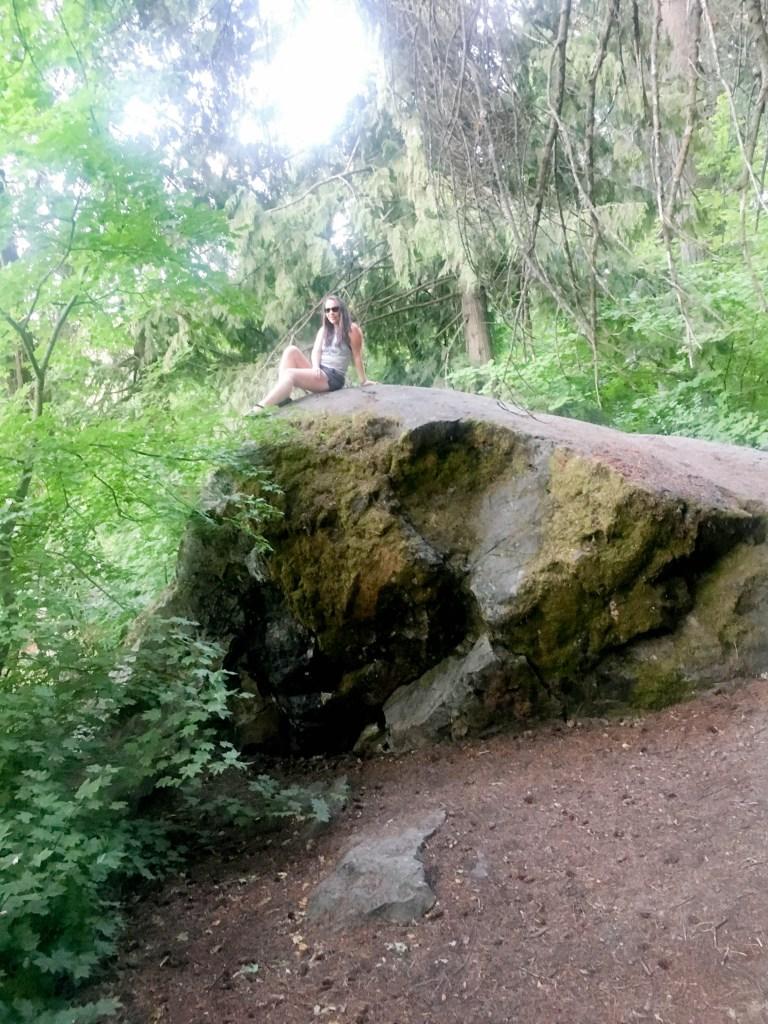 Woman on large boulder rock