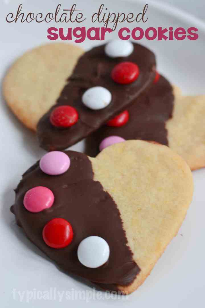 Simple sugar cookies dipped in chocolate and decorated with M&M's - a fun baking project to do with the kids!