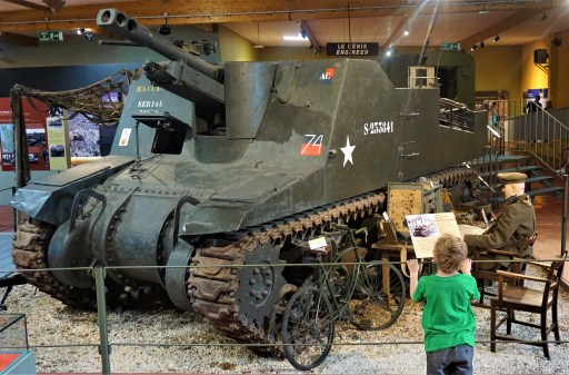 Boy in front of tank at the Memorial Museum of Normandy