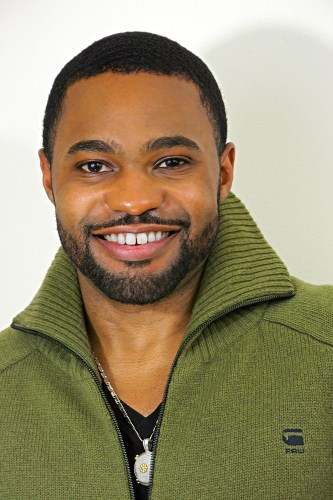 Green G-Star Raw zip up sweater menswear fashion worn by celebrities music producer Tyrone Smith