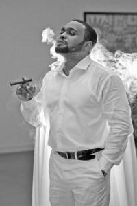 Celebrity Influenecer and muisc producer Tyrone Smith enjoys hand rolled cigars in Montego Bay Jamaica Secrets St James Resort