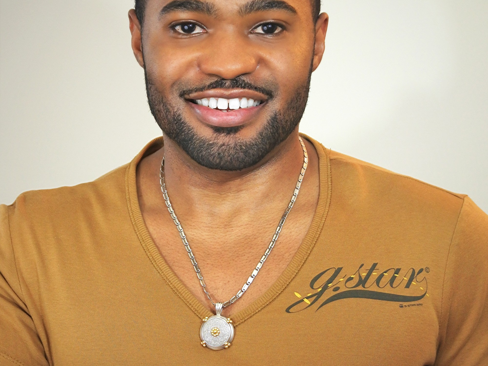Golden g-star raw shirt worn by celebrity musician, producer, and influencer Tyrone Smith