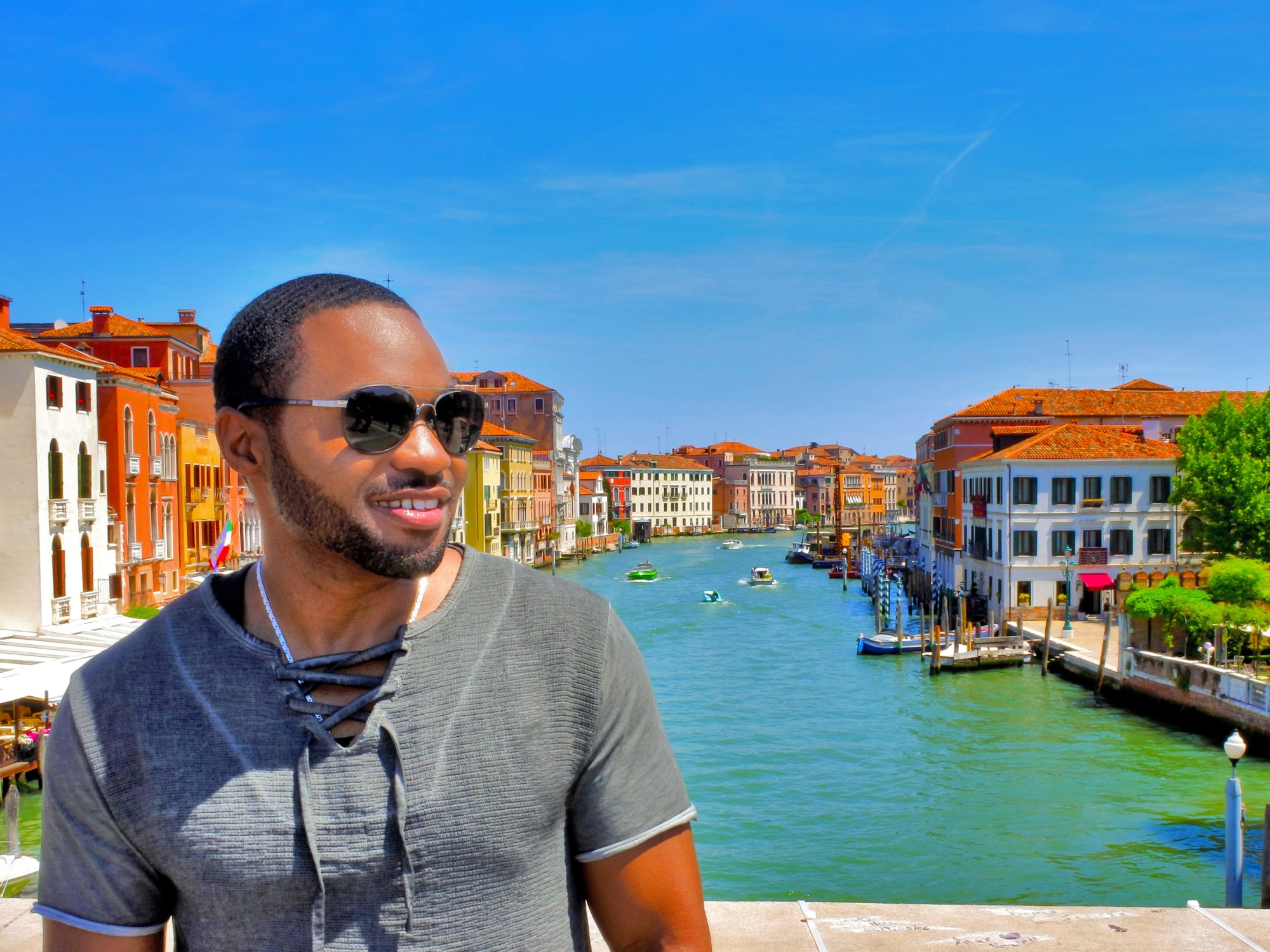 Celebrity music producer and influencer Tyrone Smith overlooking Grand Canal in Venice Italy