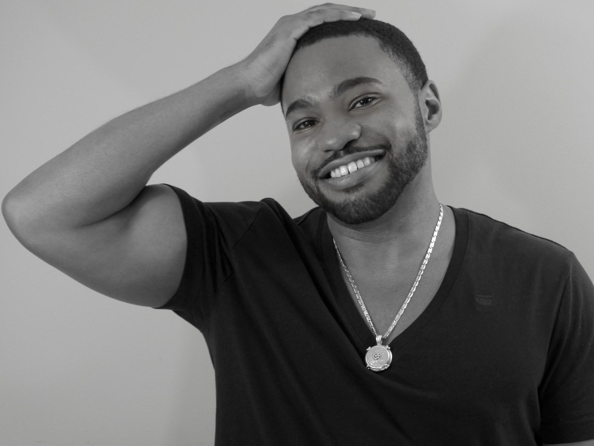Paparazzo candid shot celebrity music producer Tyrone Smith in GStar Raw