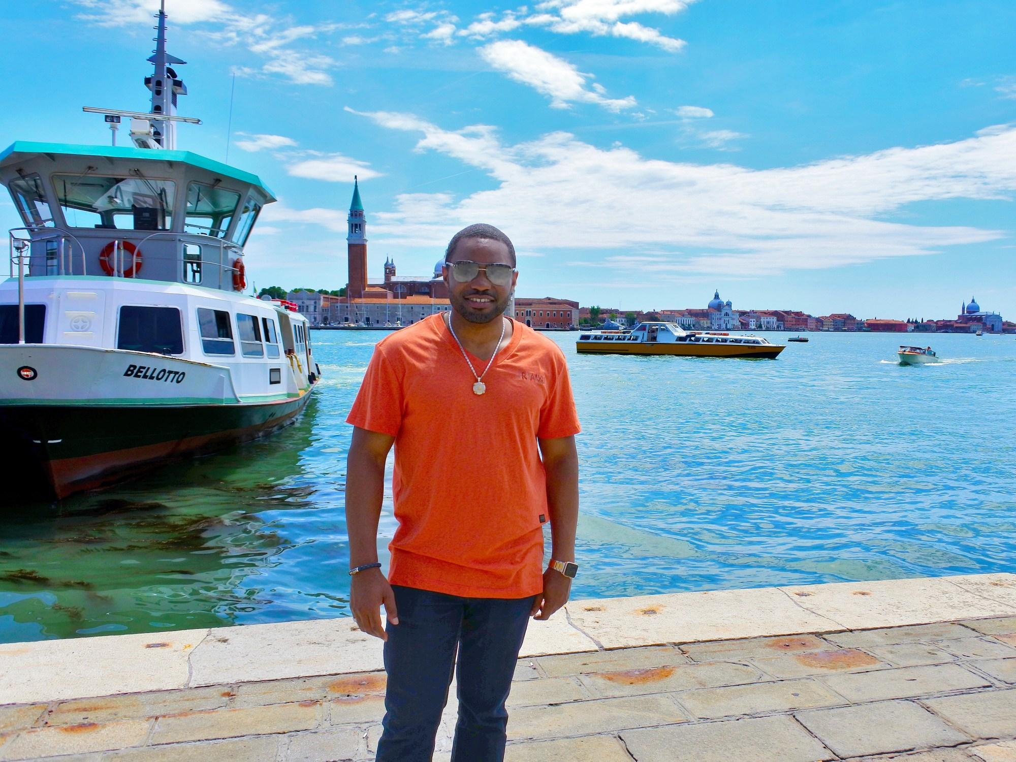 Taking in beautiful Venice Italy while wearing David Yurman, G-Star Raw, Louis Vuitton, LaPrairie Celebritiy Musician, Producer, Influencer Tyrone Smith