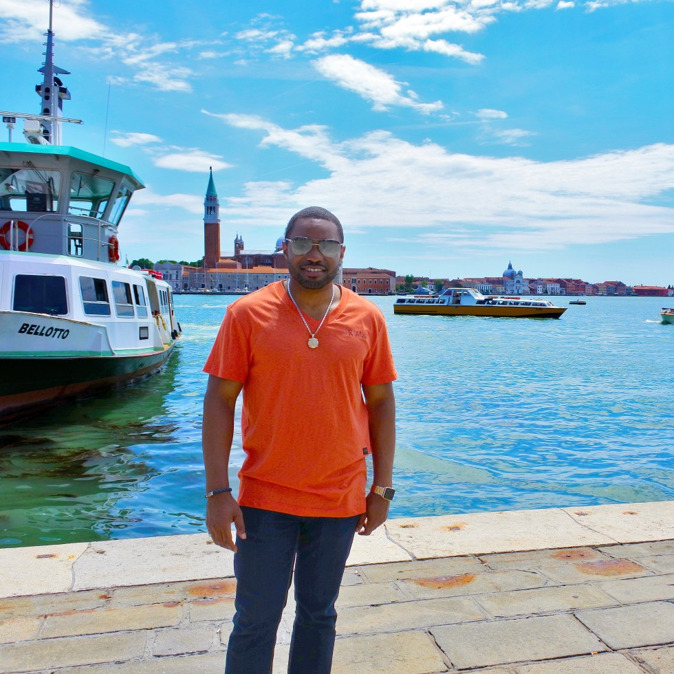 Taking in beautiful Venice Italy while wearing David Yurman, G-Star Raw, Louis Vuitton, LaPrairie Celebritiy Musician, Producer, Influencer Tyrone Smith