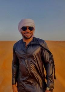 Al Hatta Desert UAE Dubai with Celebrities muisc producer Tyrone Smith wearing Louis Vuitton shades jalabiya