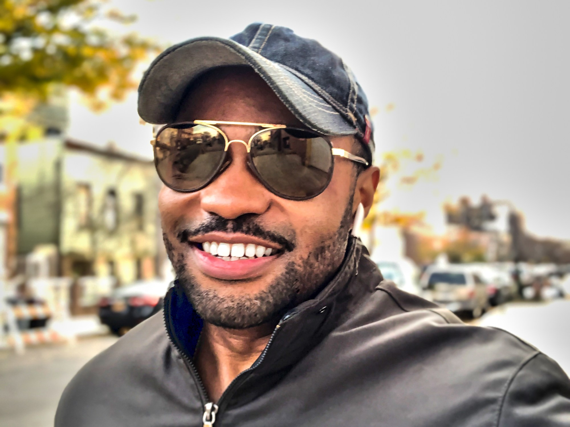 Cold Weather Vibes wearing Levi's hat Barney's Men jacket Louis Vuitton Shades NYC- Tyrone Smith American multi-instrumentalist, producer, composer, musician and entrepreneur