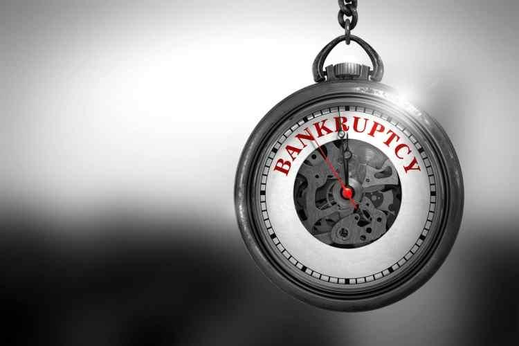 shutterstock_479478115 crisis bankruptcy bubble clock