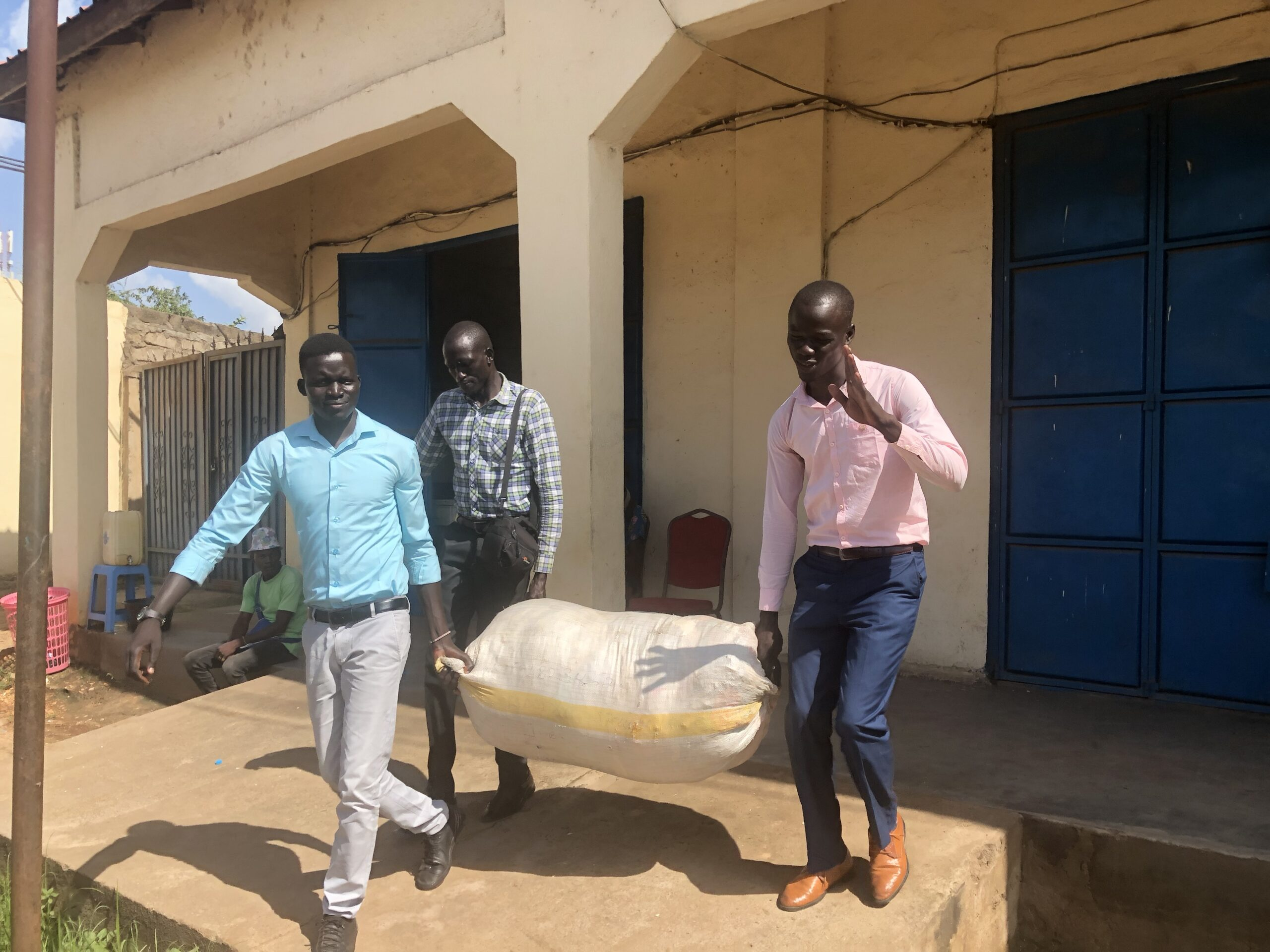 ujoss and number one citizen staff carrying their donation