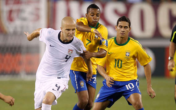 Michael Bradley, USA; Paolo Henrique Ganso, Robinho, Brazil (Getty Images)