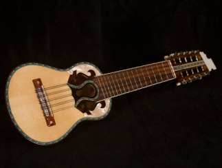 The charango is a small string instrument traditionally made out of an armadillo shell. Adapted from European instruments, the charango quickly became pervasive in the Andes. It typically has 10 strings arranged in five courses of parallel strings and can either be plucked or strummed. Tuning of the charango does not follow an ascending or descending configuration. Instead, pitches progress from high to low and then back to high. This is known as re-entrant tuning. Many myths surround both the tuning and playing of this instrument.