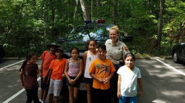 Children stand with park ranger during Granados' free Spanish-only nature camp, Summer 2016 (Photo courtesy of Ricardo Granados).
