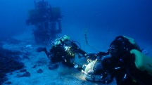Divers sealing chamber witih Pisces IV in background