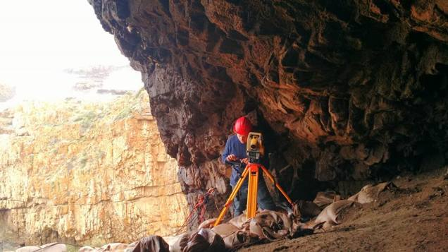 Daniel operating a total station at KEH-1 (South Africa)