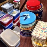 Various containers with papered butterfly specimens.