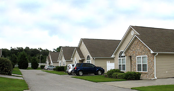 whispering woods townhomes and condos