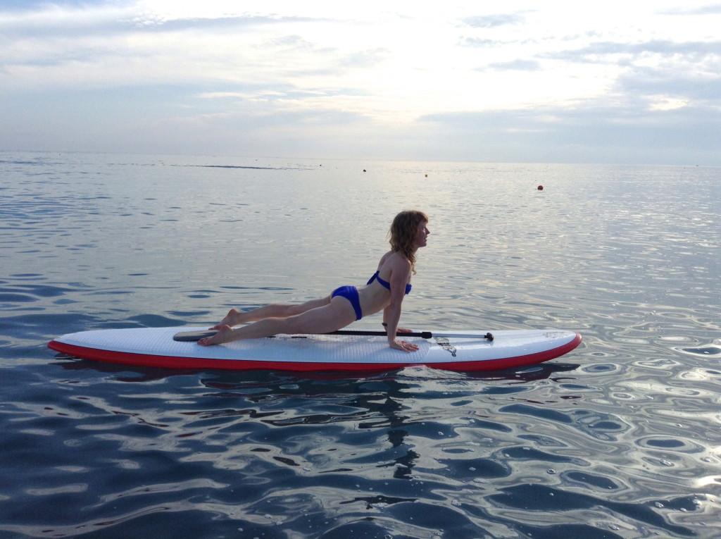 Luci Gabel, Updog Yoga on Paddleboard