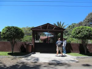 Looking at the house from the street.  It has a nice big gate around the whole property!