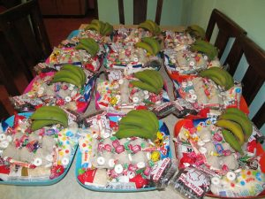 Easter blessing basket!  Each had beans, rice, sugar, milk, eggs, bananas and of course candy for the kiddos :)