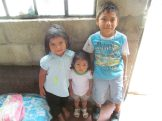 The Mateo kids with their new cross necklaces!