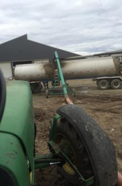 A semi tanker is loaded with liquid manure from a in ground, cement lined pit.