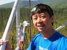 Hideki Kobayashi gathers information at Poker Flat Research Range to validate satellite data. Instruments from a 17-meter tower measure the carbon absorbed by the black spruce forest there.