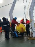 Mooring Leader Ian Waddington and Co-Chief Scientist Rob Rember removing the huge yellow float. Physical Oceanographer Marcus Janout keeps the float stable while Chemical Oceanographer Jens Hoelemann transports it to the hangar.