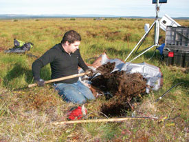 Bob Busey prepares to put temperature instruments into a soil pit on the Seward Peninsula. (Photo: J. Cherry)