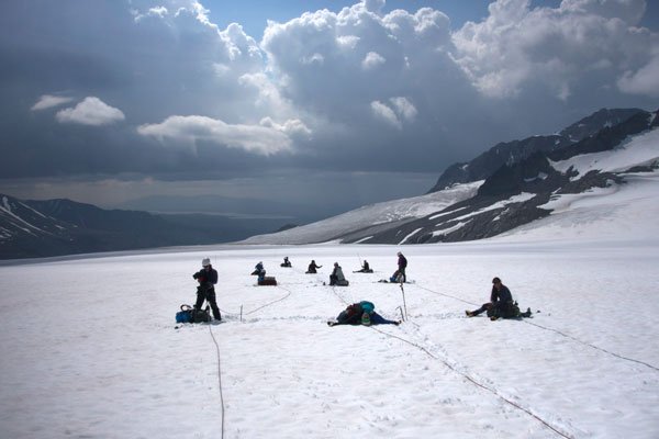 Girls on Ice 2015 instructors and participants take a lunch break on Gulkana glacier, Alaska. (Photo by Claudine Hauri)