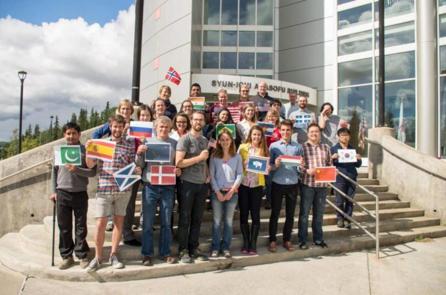 Vladimir Alexeev alongside a cohort of IARC summer school students. The program brings together students from across the globe, and gives them invaluable hands-on research experience as well as a tour of Arctic science.  The course largely focuses on the interwoven nature between data collection and modeling, with a more specific, differing focus each year.