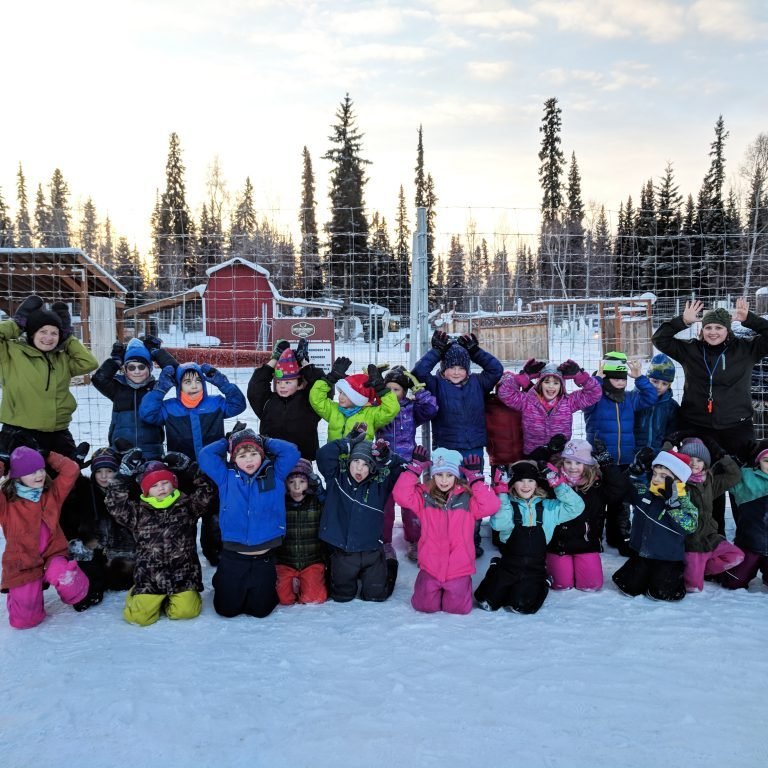 Photo courtesy of Moira O'Malley Moira O'Malley, left, poses with her Watershed Charter School students during a field trip to the Fairbanks ice park last winter. O'Malley's class will follow her this fall as she participates in a 55-day research expedition in the eastern Arctic Ocean.