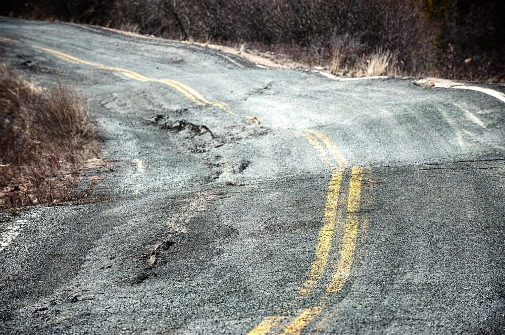 road warped by thawing permafrost