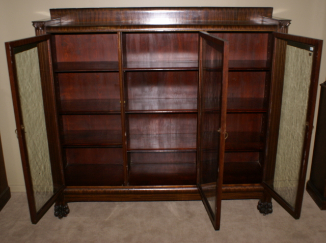 Paw foot antique mahogany triple glass door bookcase