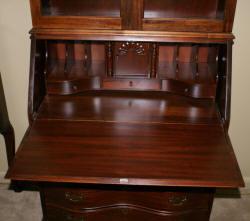 Serpentine front mahogany secretary desk